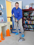 men cleaning carpet
